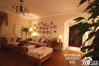 美式乡村风格三居室富裕型客厅照片墙沙发效果图