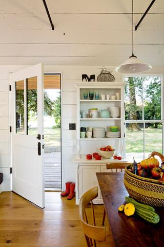 美式风格一层半别墅现代简洁客厅和餐厅的效果图