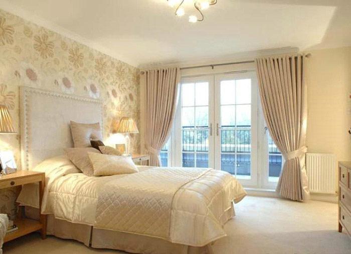 暖色调温馨卧室效果图