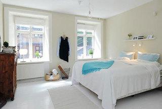 温馨米黄色卧室设计效果图