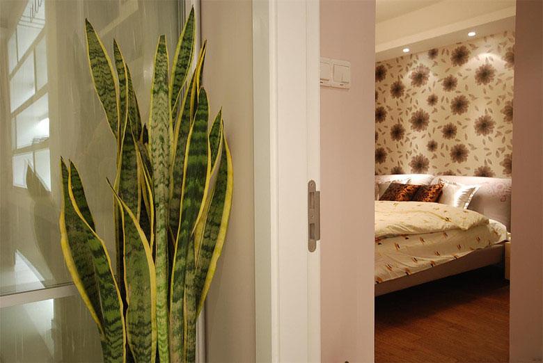 简约壁纸卧室背景墙装修效果图
