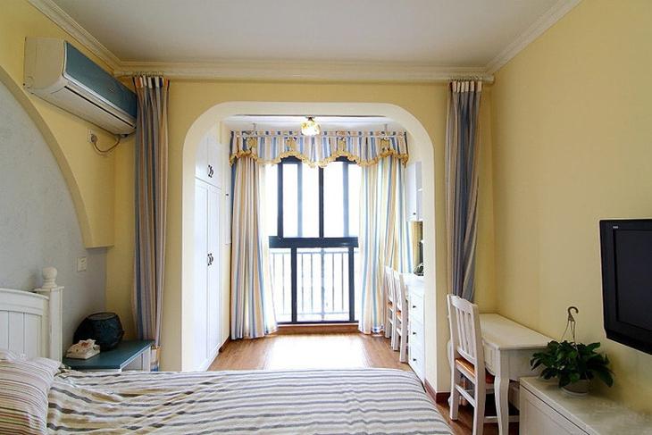 暖黄色地中海卧室 拱门隔断效果图