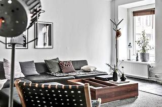 72平单身公寓装修真皮沙发图片