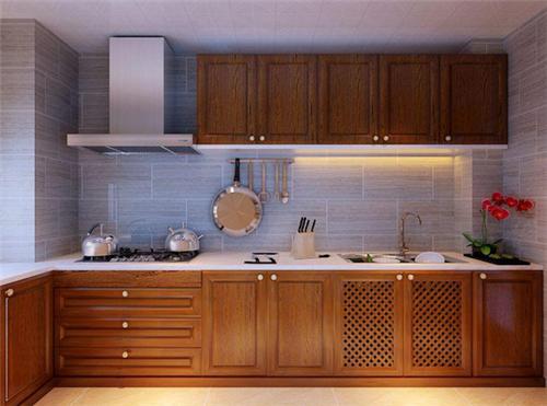 图中同样是一款中式格调的厨房,主人非常注重色彩的运用,墙...