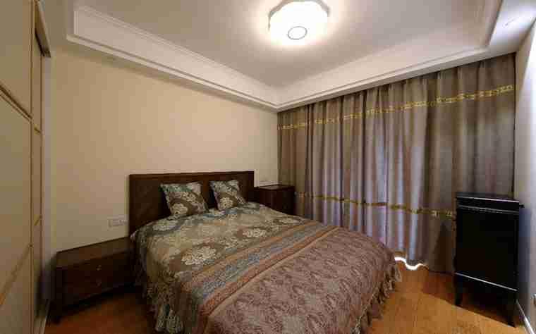 100平两居室装修卧室效果图