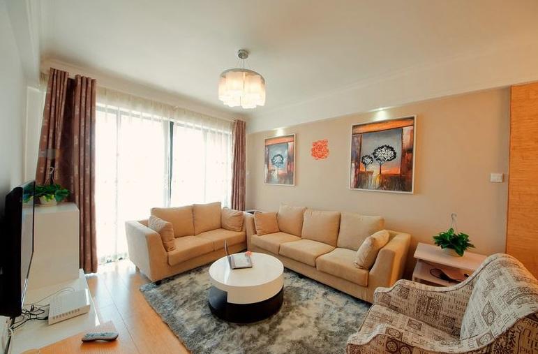 现代风格暖色系客厅装修效果图
