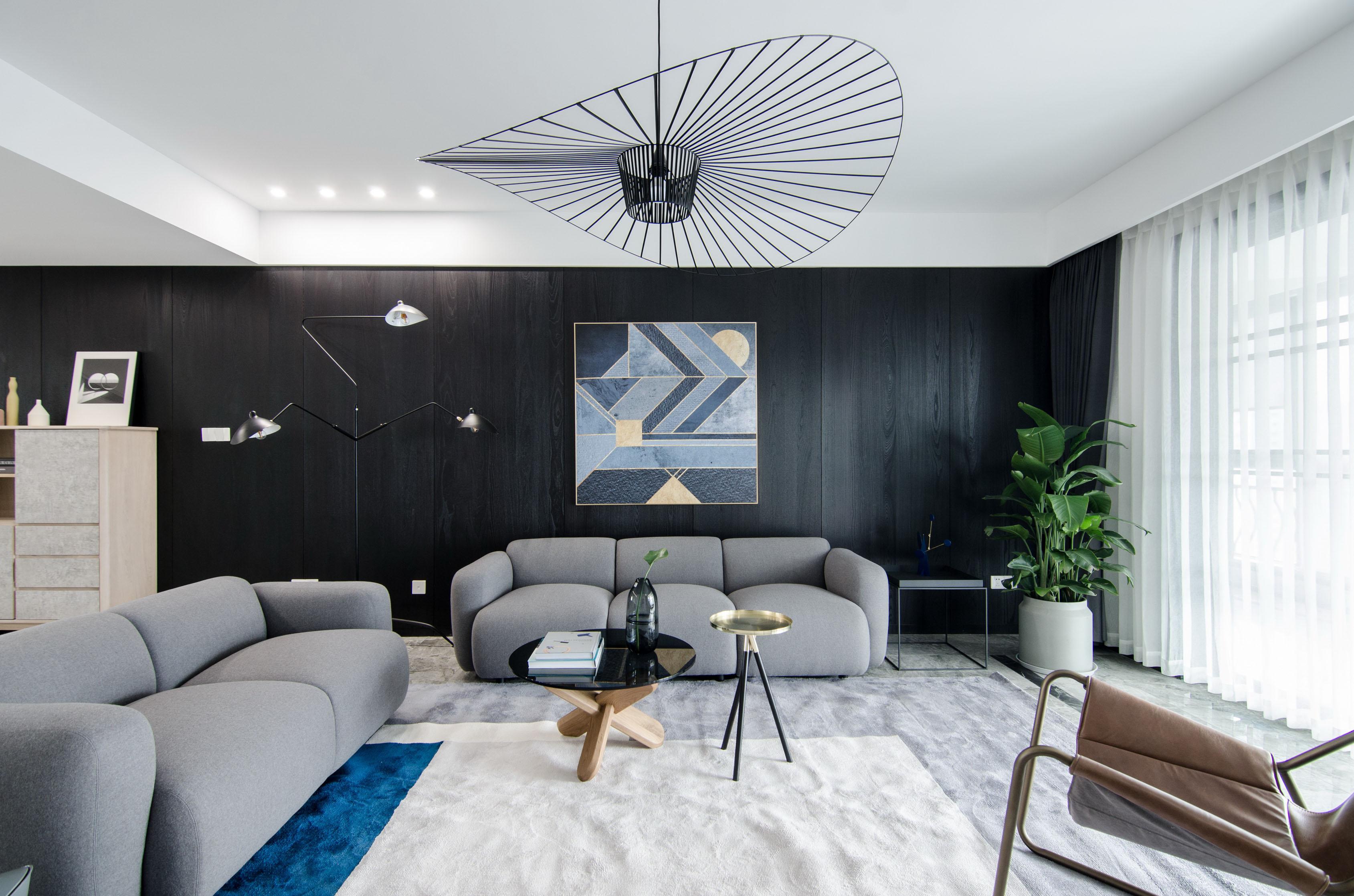 现代简约大户型黑色沙发背景墙装修效果图