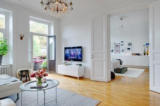 白色简约北欧风公寓电视背景墙装修效果图