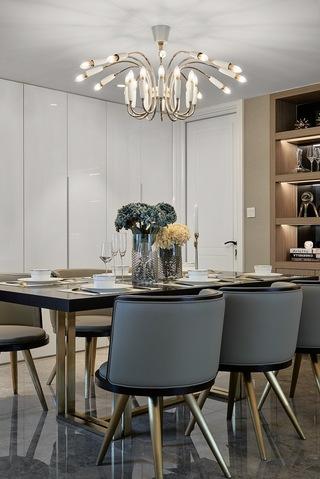 轻奢现代三居室装修餐桌椅设计图