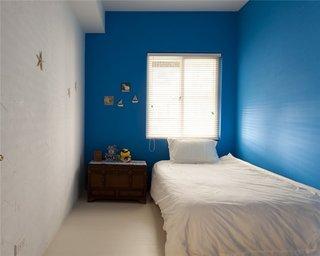 简约田园卧室蓝色背景墙装潢效果图