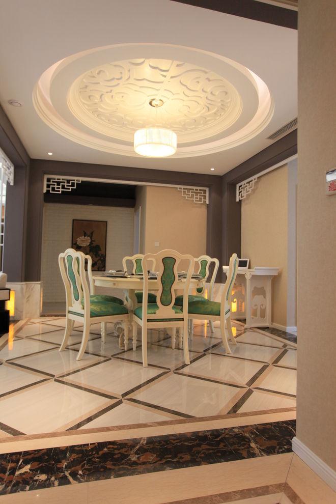 精致新中式餐厅圆形大吊顶装修