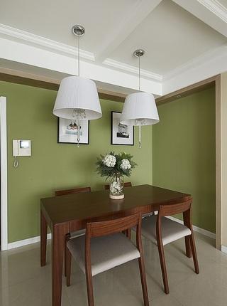 现代时尚餐厅绿色背景墙设计装饰图