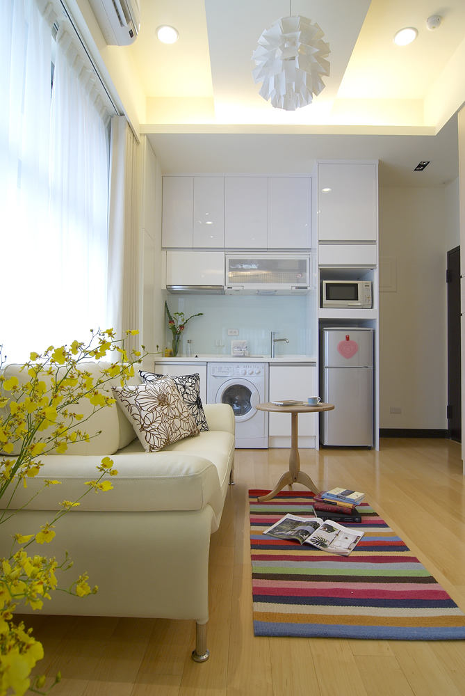 精致简约时尚装修小公寓客厅厨房一体设计